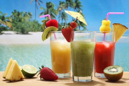 fruit cocktails kiwi pineapple strawberry on the beach