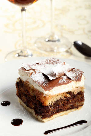 tort: chocolate cake on ceramic plate Stock Photo