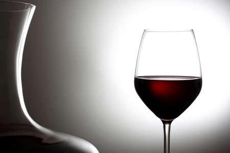 red wine in a glass  gray background Foto de archivo