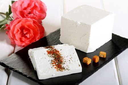 feta cheese on black stone Foto de archivo