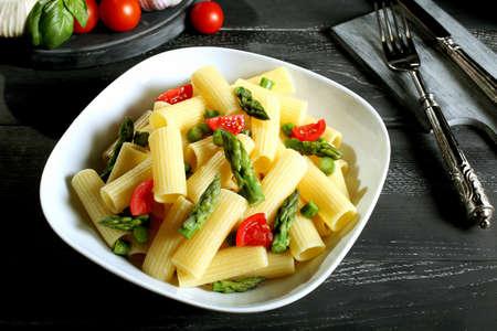 maccheroni: vegetarian pasta maccheroni with asparagus and tomatoes