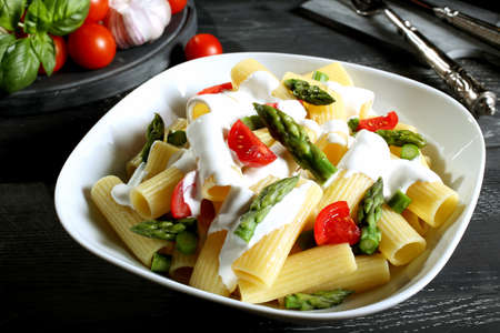 maccheroni: pasta maccheroni with asparagus tomatoes and cheese