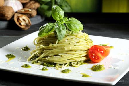 pasta with pesto genovese green background