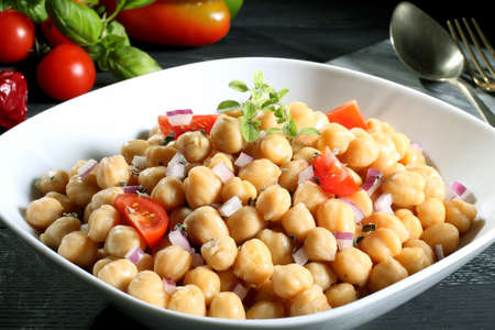 closeup chickpeas in white bowl