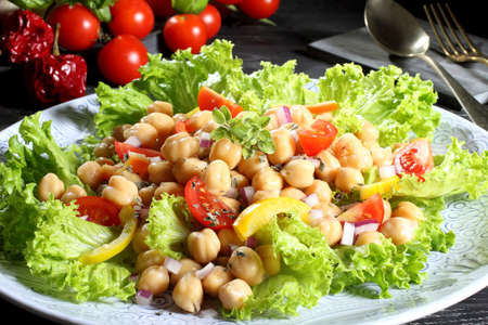 chickpea salad with tomato and pepper gray background