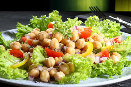 chickpea salad with tomato and pepper green background