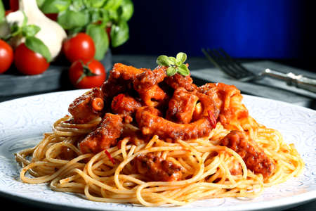 italian food pasta with octopus blue background