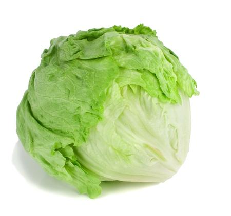 alface: Studio shot of a whole iceberg lettuce on white background. Banco de Imagens