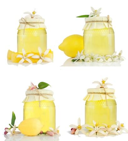Set of  honey, dried peel, lemon  and lemon flower.  Isolated on a white background with reflection. photo