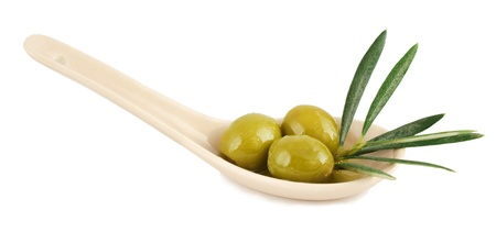 antipasti: Olives in a spoon on a white background Stock Photo