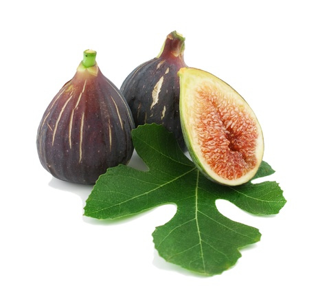 Ripe fresh purple fig fruits  and leaf on white background Stock Photo