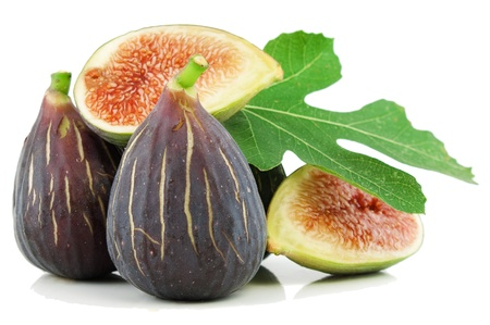 fig leaf: Ripe fresh purple fig fruits  and leaf on white background Stock Photo