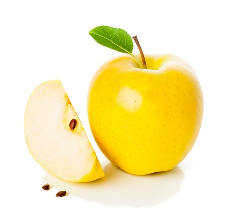 golden apple:  Yellow apple and its slice  with green leaf isolated on white Stock Photo