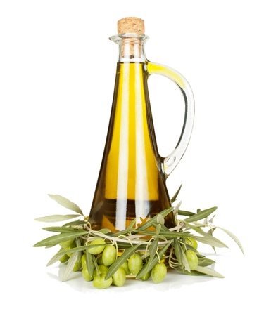 Olive oil in a glass bottle and a branch of an olive tree with fruits isolated on white