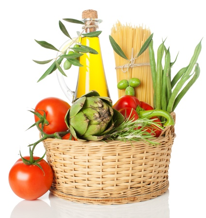 spaghetti (pasta) , olive oil and  vegetables in a basket.  Isolated  on a white background.  Stock Photo