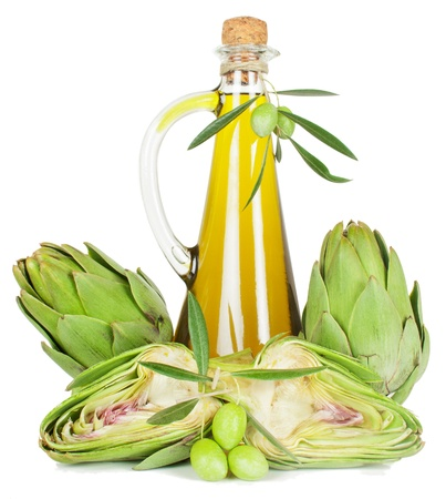 Fresh artichokes, olive oil in a glass bottle and a branch of an olive tree with fruits. Isolated on a white background.  Stockfoto
