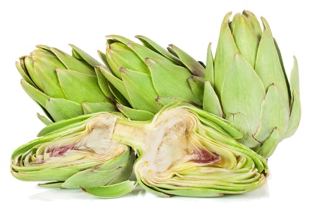 Artichoke fresh,  whole and half.  Isolated on a white background.