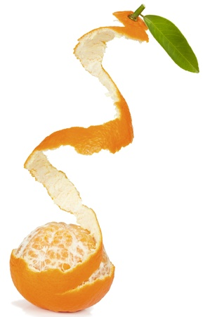 Half peeled  mandarin with leaf. Isolated on a white background.