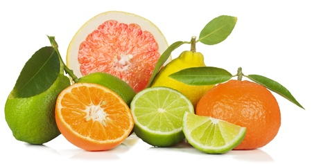 Lime,  tangerine, lemon and  grapefruit: whole and  section with green leaves isolated on white. photo