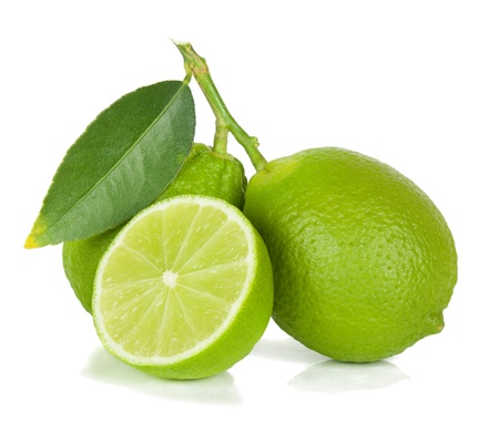Two limes with section isolated on a white background  Stock Photo