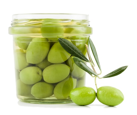 Pickled olives in glass jar and fresh olives on the branch  with leaves  isolated on a white background.
