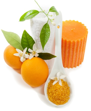 spa still life: Spa still life with orange, blossom, candle, towel,  salt  isolated on a white background.  Stock Photo