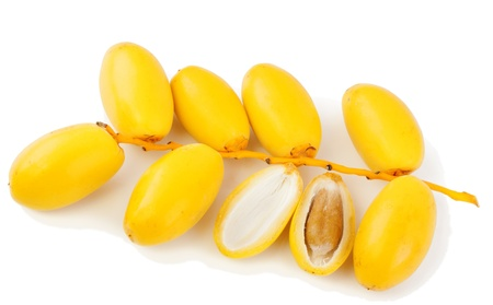 up to date: A bunch of fresh date fruits, one fruit is broken in half, the stone is visible  Isolated on white background