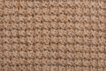 Close-up of a piece of knit fabric  beige color photo