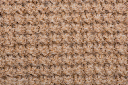 interweaving: hand-knitted beige close-up