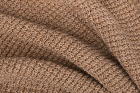 Beige  knitted  woolen curve texture photo
