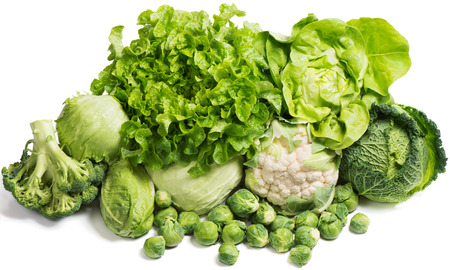 Fresh green vegetables isolated on a white background photo
