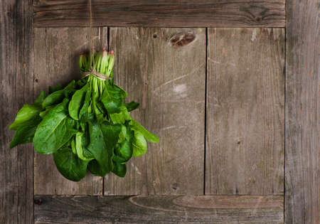 spinach: Fresh harvested spinach, on a old  table   Stock Photo