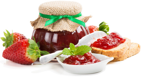 preserving: Toast with strawberry jam and fruits isolated on a white background.