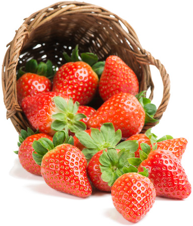 strawberry baskets: underlying basket with strawberries spilling on a white