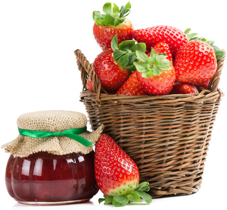 A basket of strawberries and jam  in the bank isolated on a white background  photo