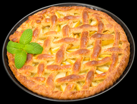 Home made apple pie with lattice isolated on  black photo