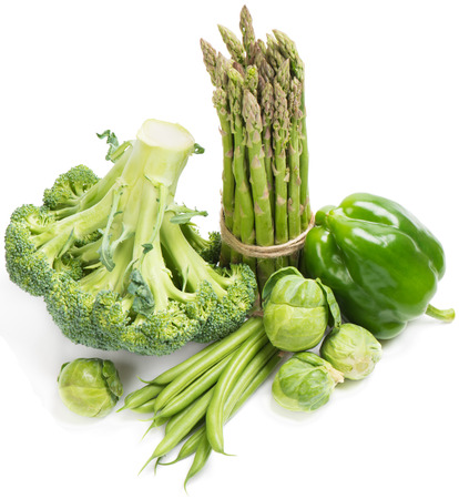 Set of green vegetables from the  asparagus, green beans, brussels sprout, bell pepper, and broccoli. On a white background.  photo
