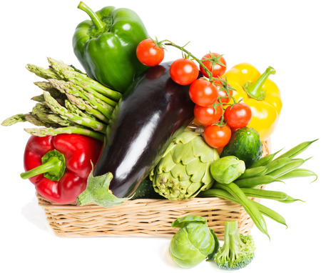 A set of vegetables in wicker basket isolated on white photo