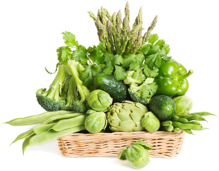 Various fresh green vegetables in basket isolated on white  photo