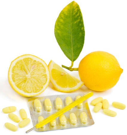 Lemon, pills  and Thermometer on white background. Selective focus. Focus on thermometer.  photo