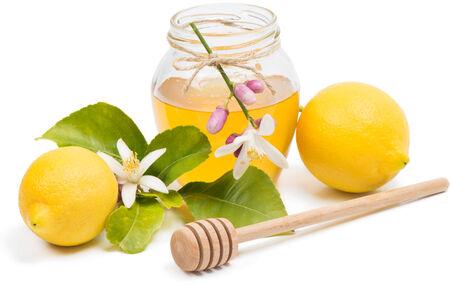 blossom honey: honey, lemon and blossom  isolated on white Stock Photo