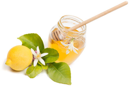 honey, lemon and blossom  isolated on white background photo