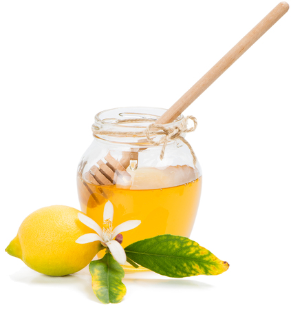 Honey jar and lemon with flower,  isolated on white background   Stock Photo