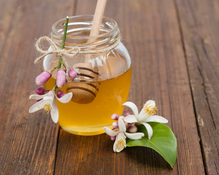 lemon tree: honey  and blossom of a lemon tree on the wooden table.  Stock Photo