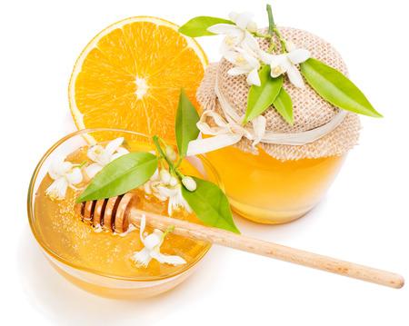 blossom honey: Honey of flowers  orange tree, blossom, orange fruit; isolated on white background.