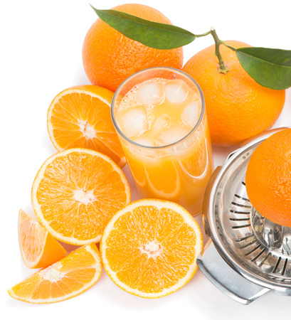 Cold orange juice in the glass  with ice cubes and fresh pieces of oranges  Focus is on a juice surface, top view. photo