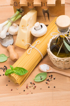spaghetti , olive oil, champignons, garlic and cheese over wooden  background photo