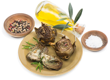 free plate:  Grilled artichoke, served with olive oil, pepper and salt  Isolated on white background,