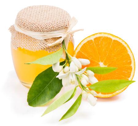 blossom honey: Honey of  blossom of orange,  fruit. Isolated on white background.  Stock Photo
