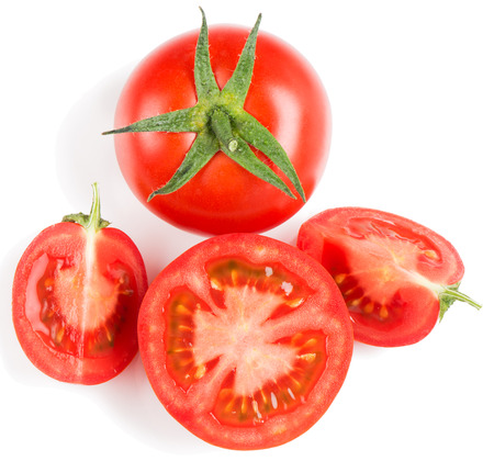 Tomato slice and whole isolated on white background, top view
